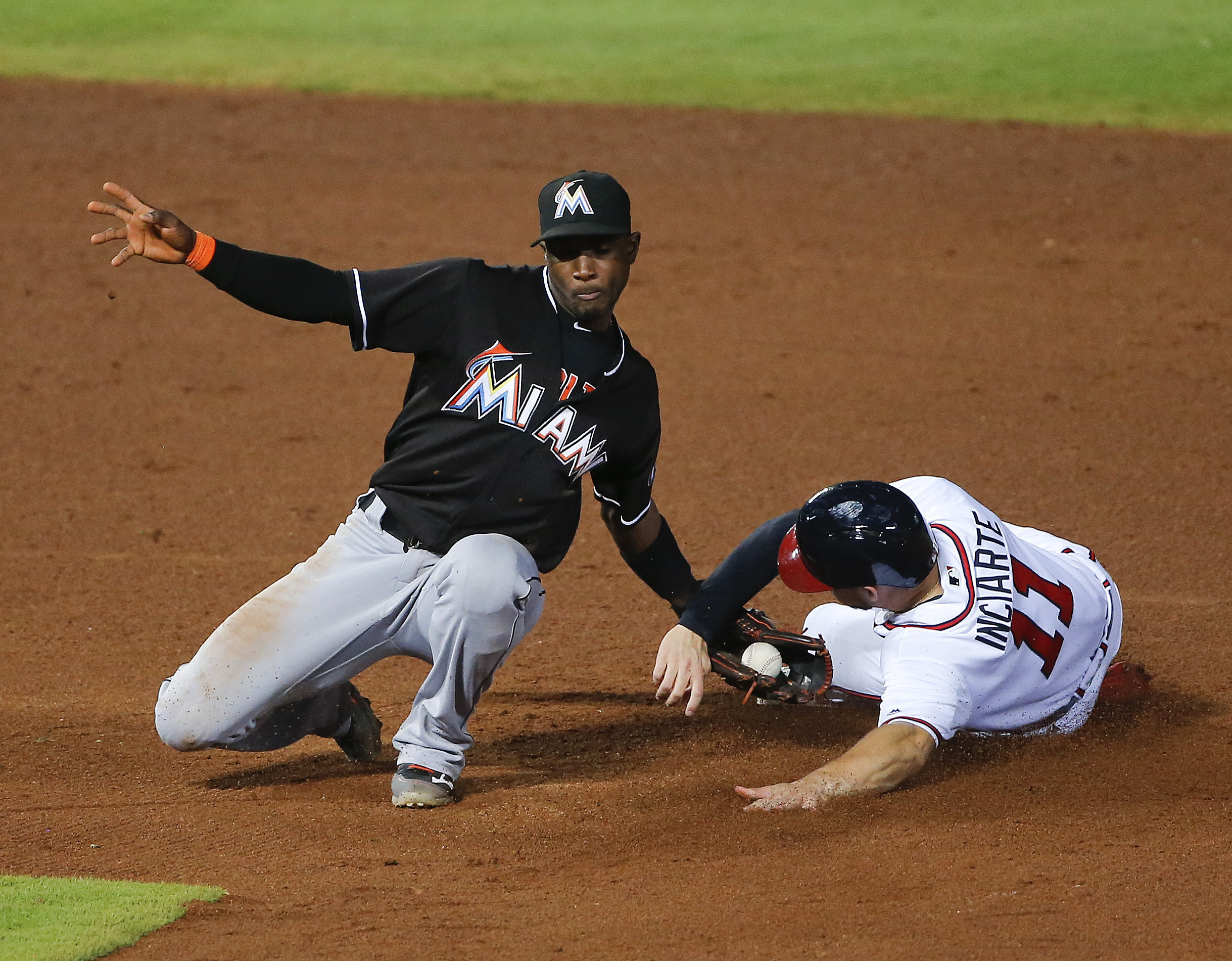 Atlanta Braves' Ender Inciarte (11)steals second base as Miami Marlins shortstop Adeiny Hechavarria, left, applies the late tag in the fifth inning of a baseball game Friday, July 1, 2016, in Atlanta. (AP Photo/John Bazemore)